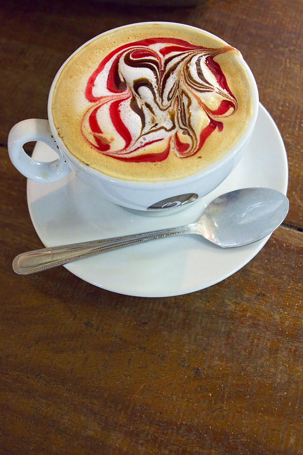 Gourmet Latte With Red And Brown Swirls Photograph By