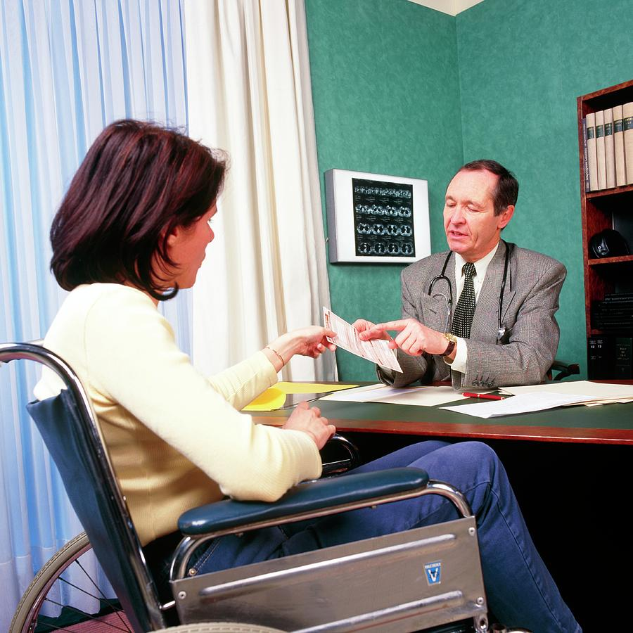 Consultation Photograph - Gp Doctor Gives A Prescription To A Disabled Woman by Cc Studio/science Photo Library