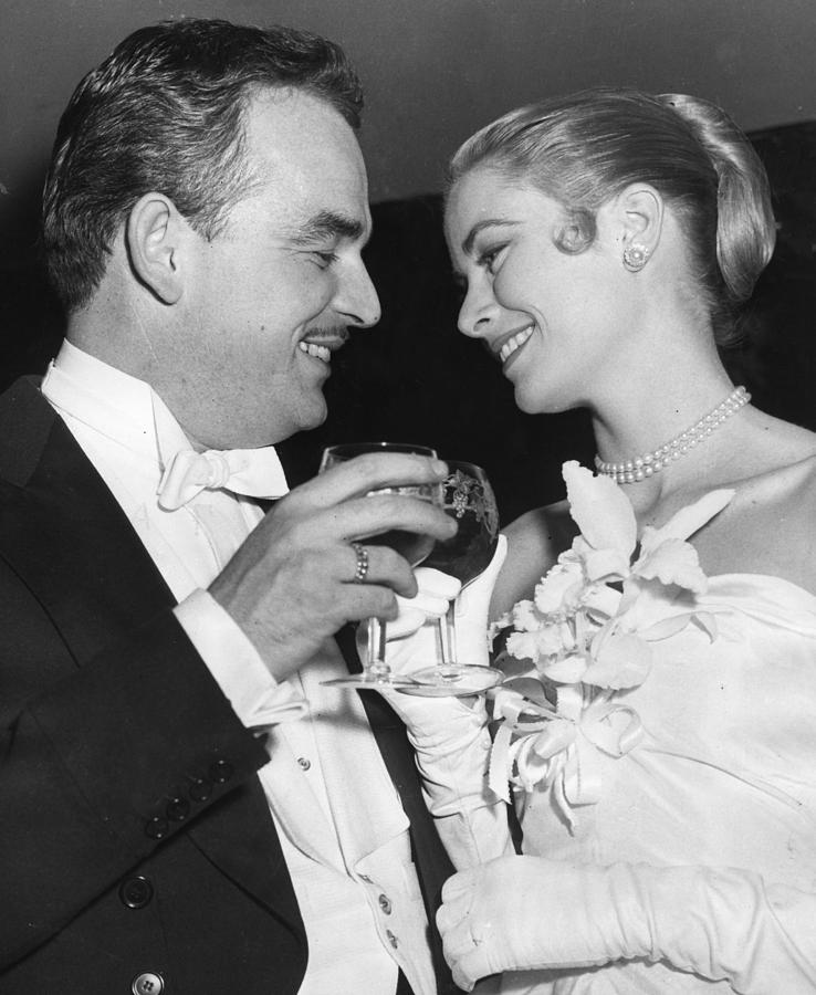 Grace Kelly Toasts With Husband Photograph By Retro Images