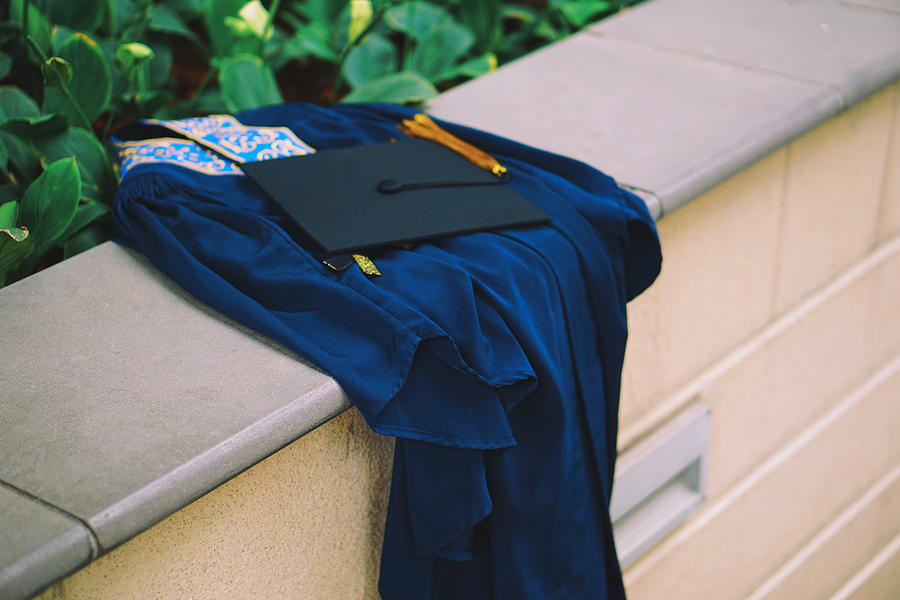 Graduation Gown With Mortarboard On Retaining Wall Photograph by Danial Najmi / EyeEm