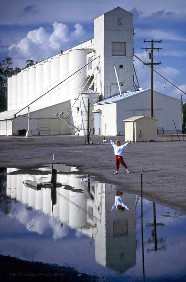 Grain Elevators Photograph - Grain Elevators And Child by Michael Moore