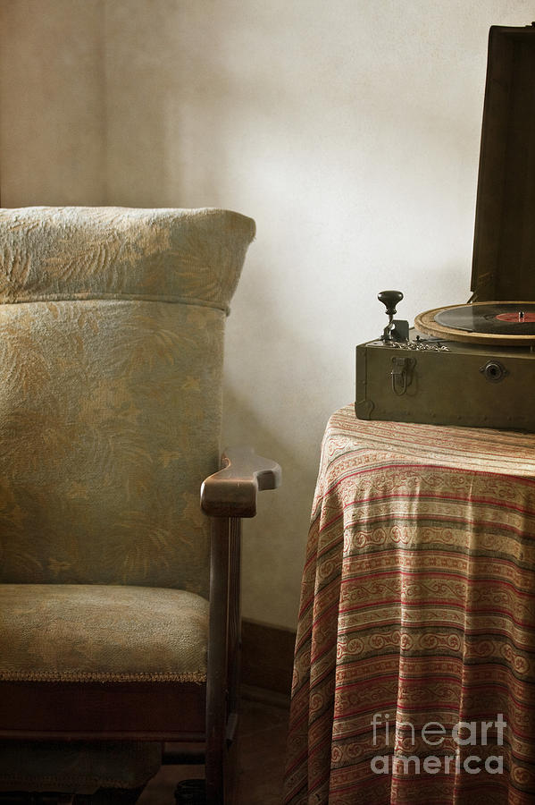Vintage; Antique; Chair; Interior; Still Life; Living Room; Sitting Room; Casual; Indoors; Room; Furniture; Nobody; Empty; Table; Comfort; Cloth; Record; Record Player; Music; Sound; 1940s; Walls; Dirty; Old Photograph - Grandmas Chair by Margie Hurwich