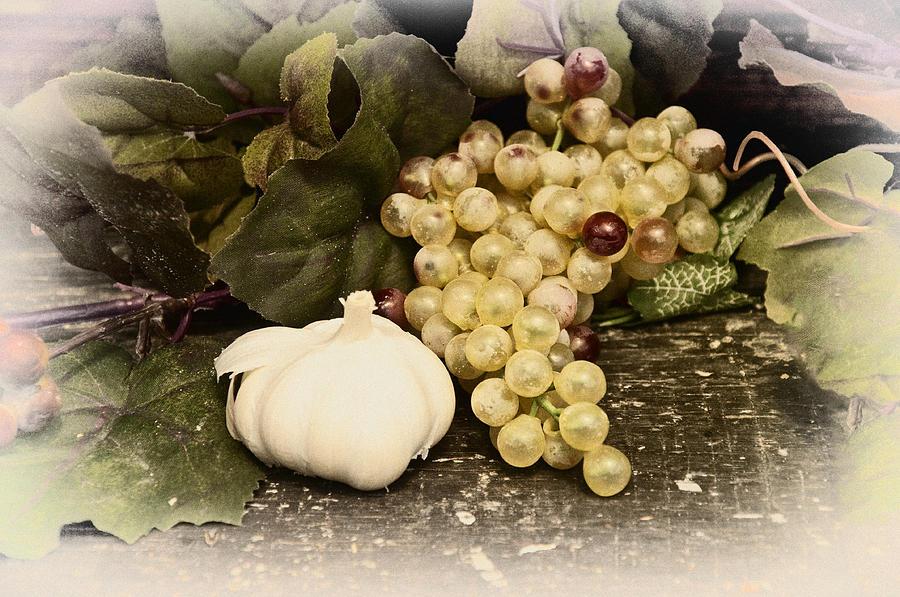 Garlic Photograph - Grapes And Garlic by Bill Cannon