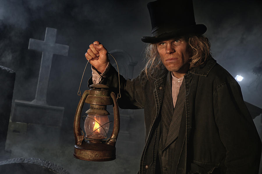 Grave digger with lantern Photograph by Jay P. Morgan