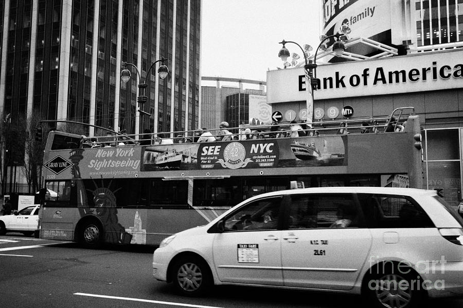 Usa Photograph - Gray Line New York Sightseeing Bus And Yellow Mpv Taxi Cab On 7th Avenue New York City by Joe Fox