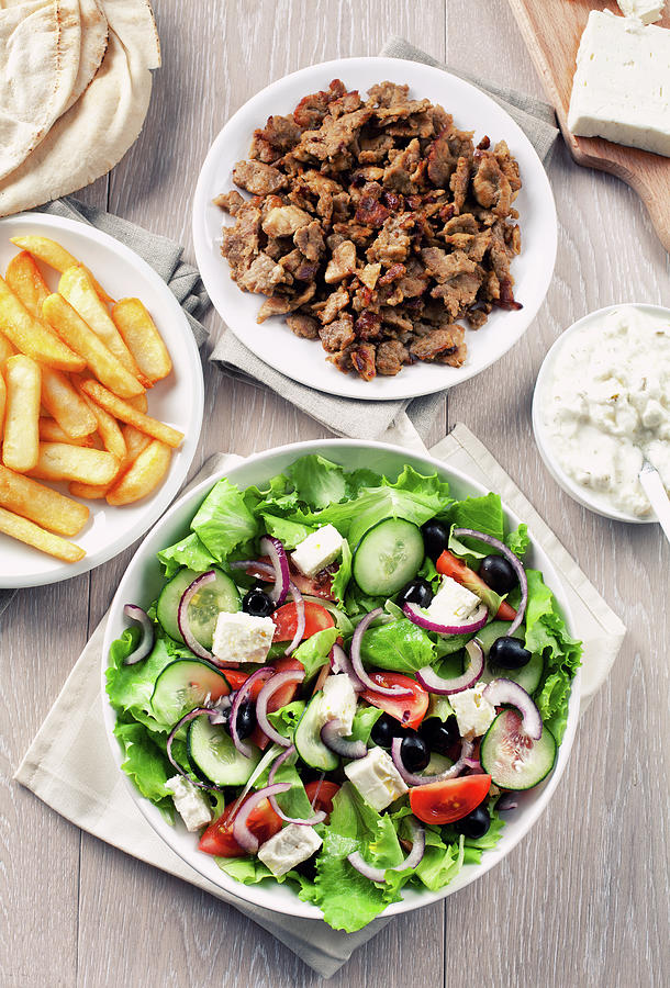 Greek Salad With Gyros And Fries Photograph by Svariophoto