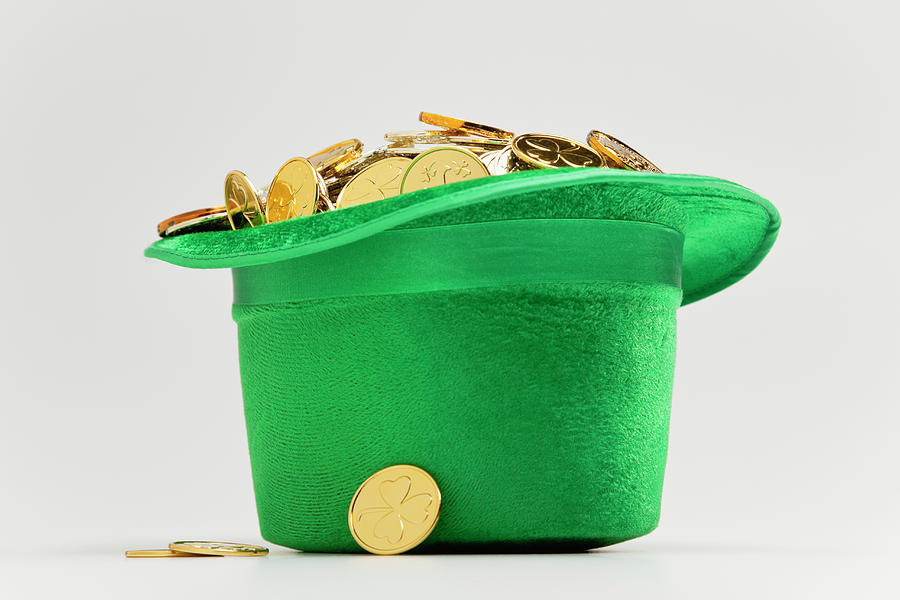 Green Hat Filled With Golden Coins Photograph by Vstock Llc