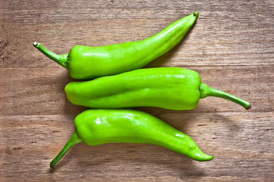 Board Photograph - Green Jalapeno Peppers by Tom Gowanlock