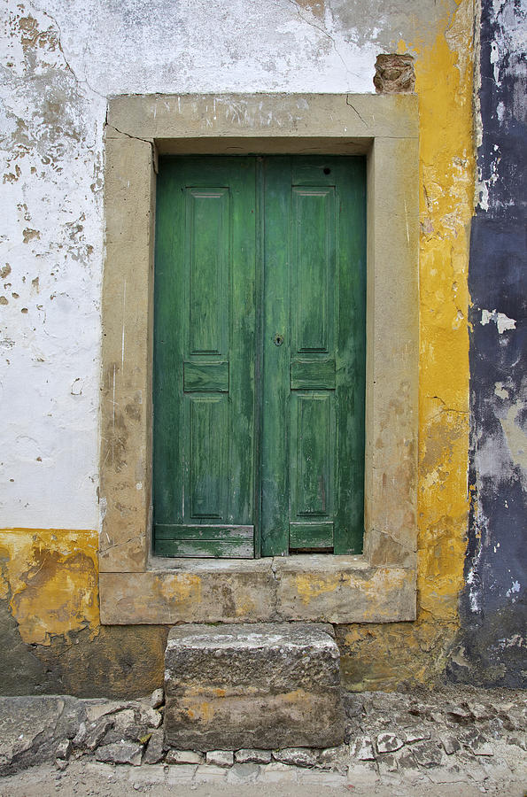 Art Photograph - Green Wood Door With Hand Carved Stone Against A Texured Wall In The Medieval Village Of Obidos by David Letts