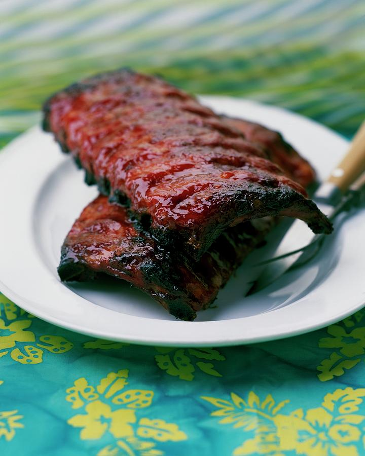Grilled Ribs On A White Plate Photograph by Romulo Yanes