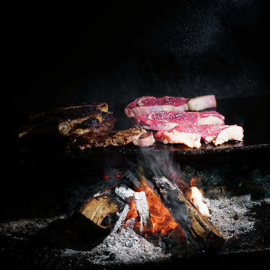 Grilled Photograph - Grilling Steaks by Ron Koeberer