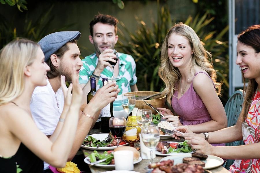 Group Of Friends Eating Lunch Outdoors Photograph by Science Photo Library