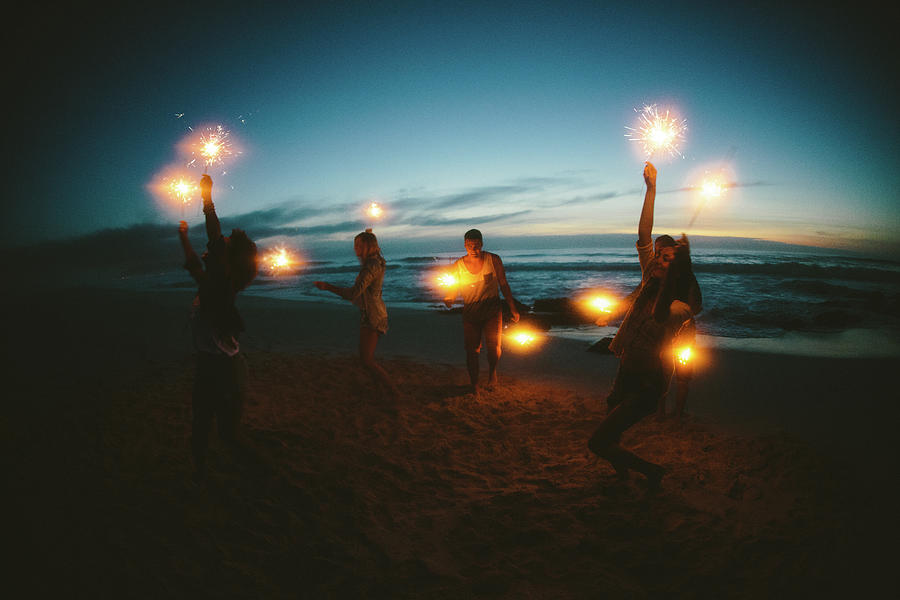 Group Of Friends With Fireworks Photograph by Wundervisuals