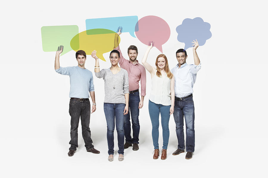Group of people holding individual speech bubbles. Photograph by Ezra Bailey