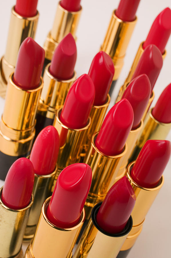 Cosmetics Photograph - Group Of Red Lipsticks by Garry Gay