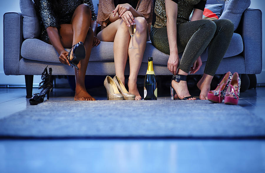 Group Of Women Putting On Heels Before Night Out Photograph by Mike Harrington