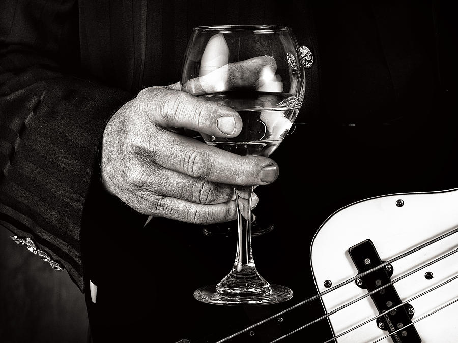 Guitar Player And A Glass Of Wine Photograph by James David Phenicie