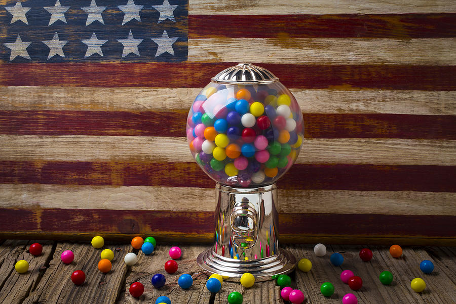 Bubblegum Machine American Photograph - Gumball Machine And Old Wooden Flag by Garry Gay