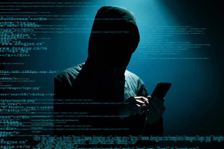 Hacker using phone Photograph by Xijian
