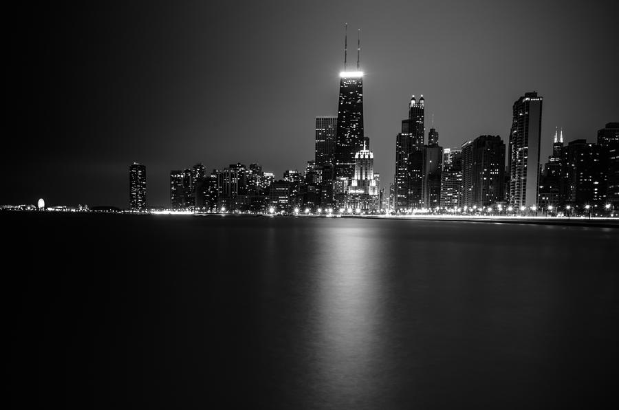 Chicago Photograph - Hancock Building Reflection From North Ave Beach - Black And White by Anthony Doudt
