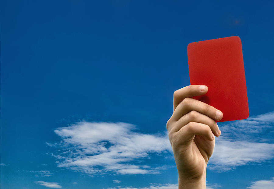 Hand holding red card against blue sky Photograph by Stefano Oppo