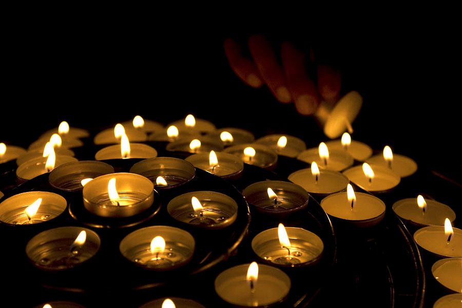 Close Up Photograph - Hand Lighting Candles by Fabrizio Troiani