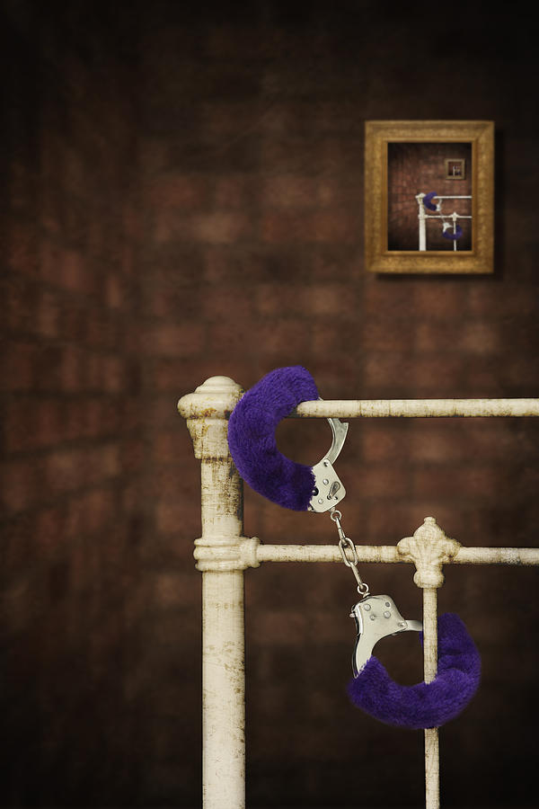 Handcuffs Photograph by Amanda Elwell