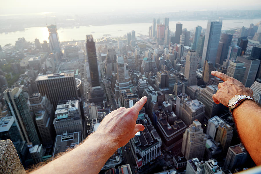 Hands Pointing At City As Seen From Photograph by Chris Tobin