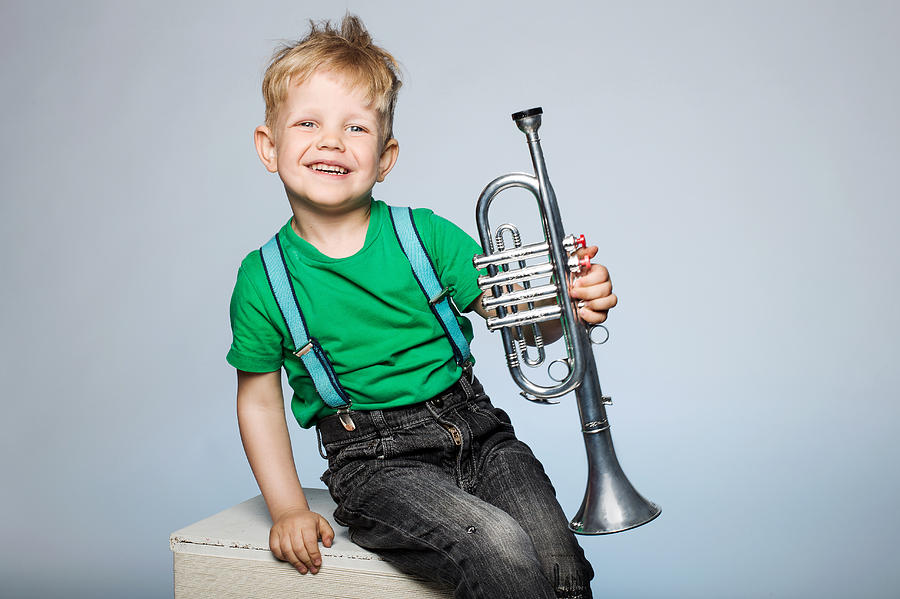 Happy Child With Trumpet Photograph