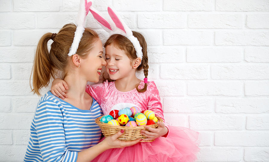 Happy easter! family mother and child daughter with ears hare getting ready for holiday Photograph by Evgenyatamanenko