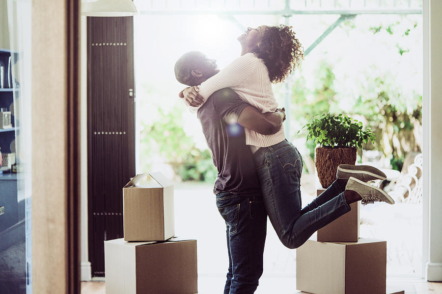 Happy Man Lifting Woman In New House Photograph by Portra