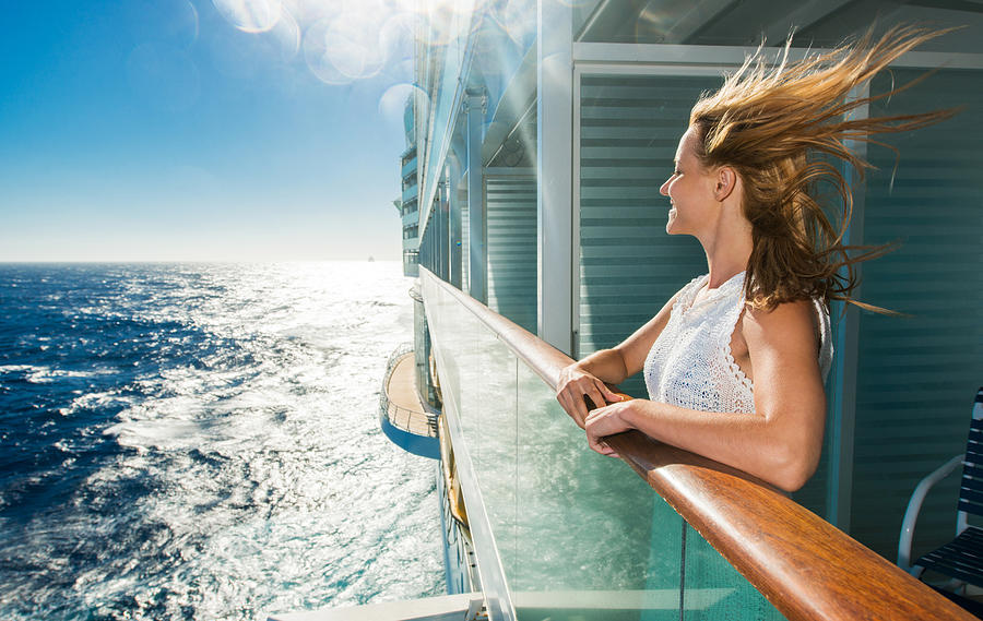 Happy woman looking at sea from a cruise ship. Photograph by BraunS