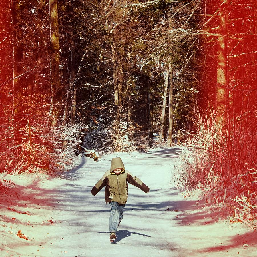 Boy Photograph - Happy Young Boy Running In The Winterly Forest by Matthias Hauser