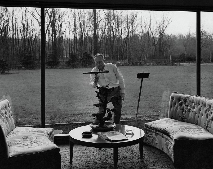 Harold M Sloan Cleaning A Glass Wall Photograph by Hedrich Blessing