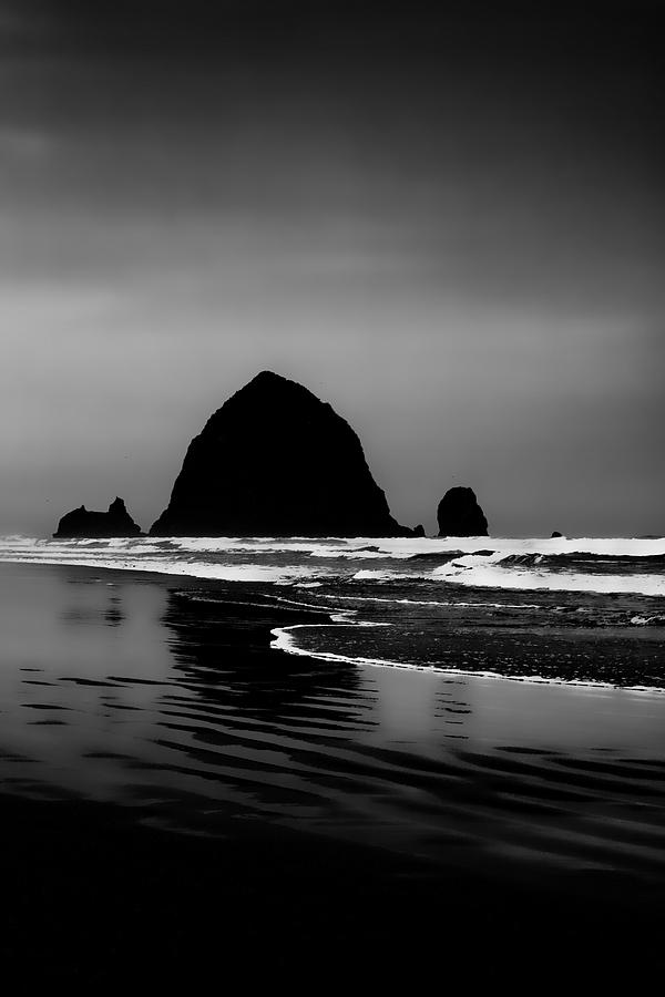 Black And White Photograph - Haystack Rock On Cannon Beach by David Patterson
