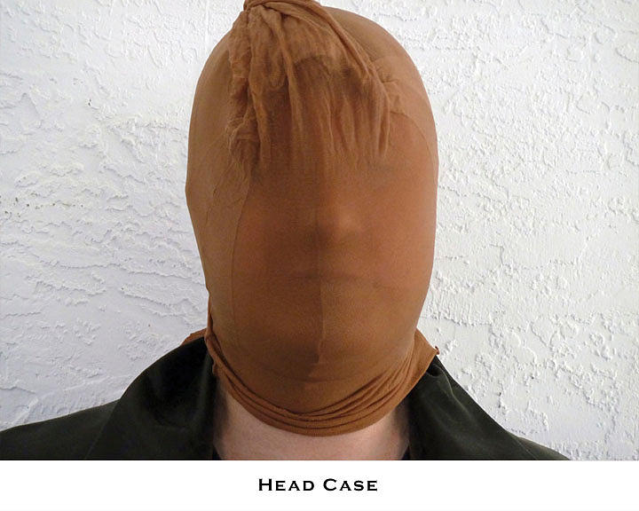 Disguise Photograph - Head Case by Lorenzo Laiken