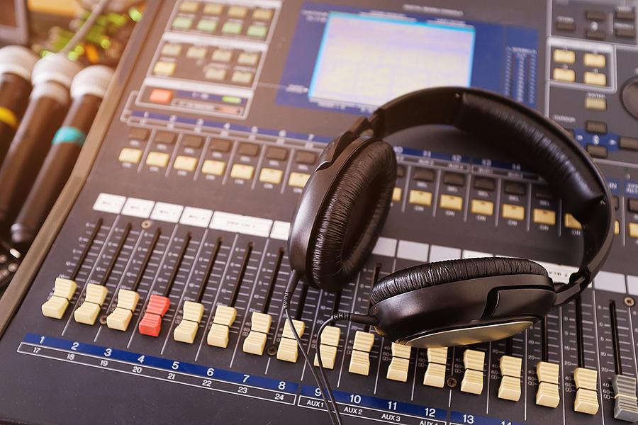 Headphones, Microphones, Amplifying Equipment, Studio Audio Mixer Knobs And  Faders, Background Sound Mixer  Workplace And Equipment Sound Engineer