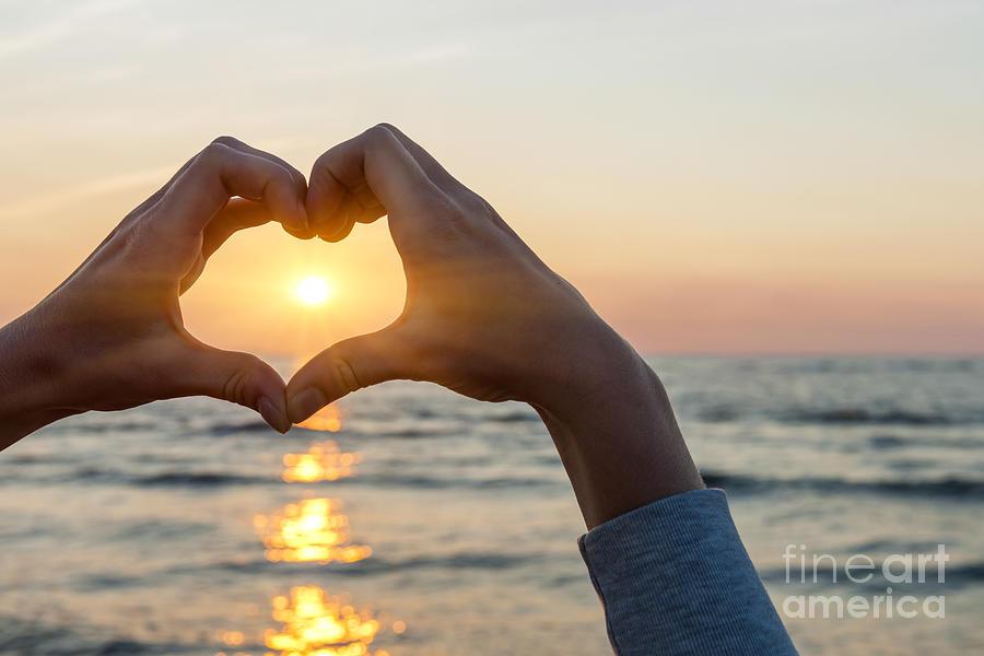 Heart Photograph - Heart Shaped Hands Framing Ocean Sunset by Elena Elisseeva
