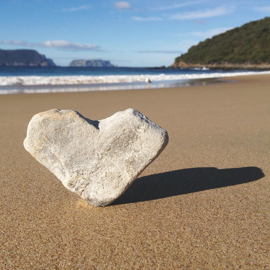 Heart Shaped Rock Sitting In Sand At Photograph by Jodie Griggs