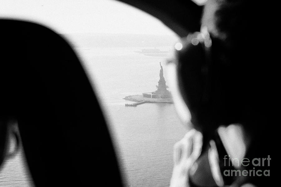 Usa Photograph - Helicopter  Flies Over Statue Of Liberty As Seen Through The Plexiglas New York by Joe Fox