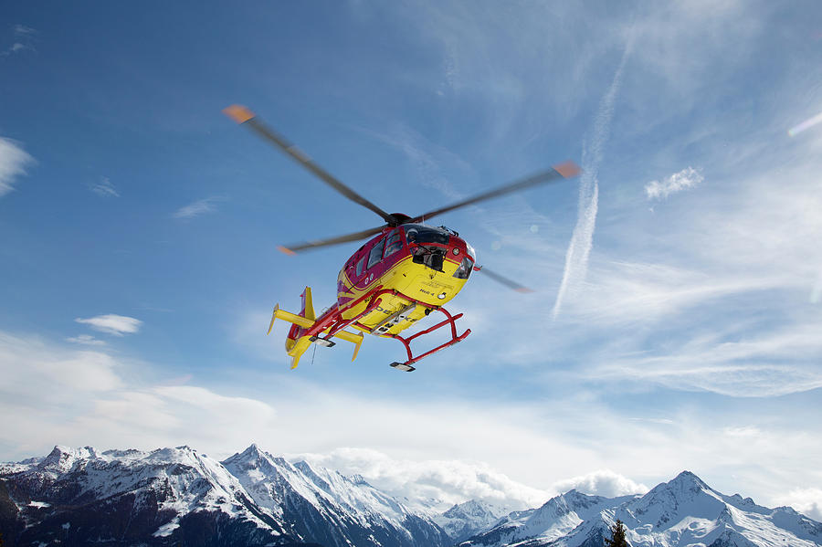 Helicopter In The Mountains Photograph by Chris Tobin