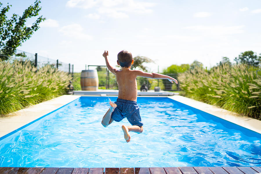 Hello Summer Holidays - Boy Jumping In Swimming Pool Photograph by Amriphoto