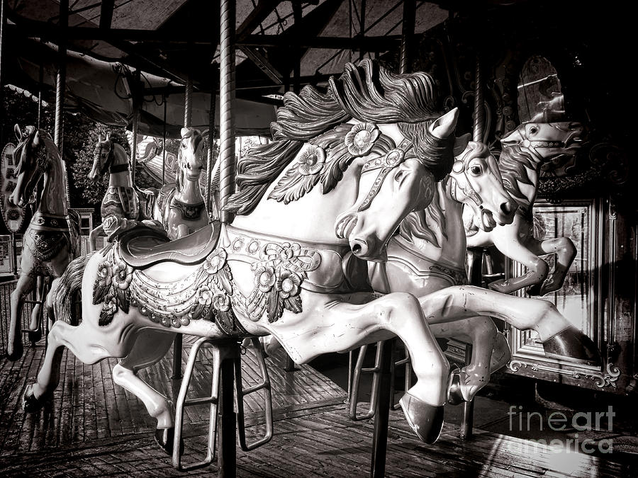 Carousel Photograph - Heroic  by Olivier Le Queinec