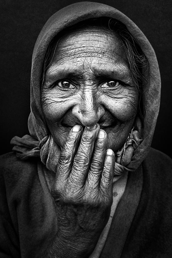 Portrait Photograph - Hidden Smile by Nidhal Alsalmi