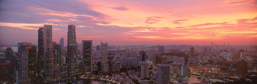 Color Image Photograph - High Angle View Of A City At Sunset by Panoramic Images