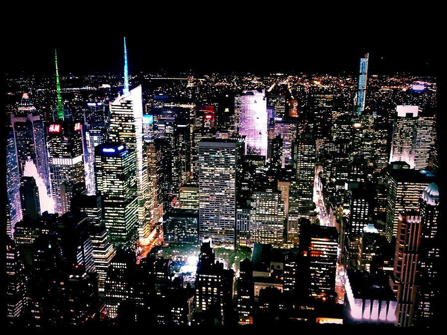High Angle View Of Cityscape Lit Up At Photograph by Paolo Tahalele / Eyeem