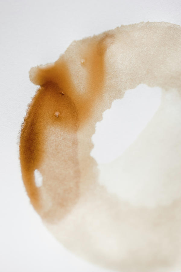 High Angle View Of Coffee Stains On Photograph by Johner Images
