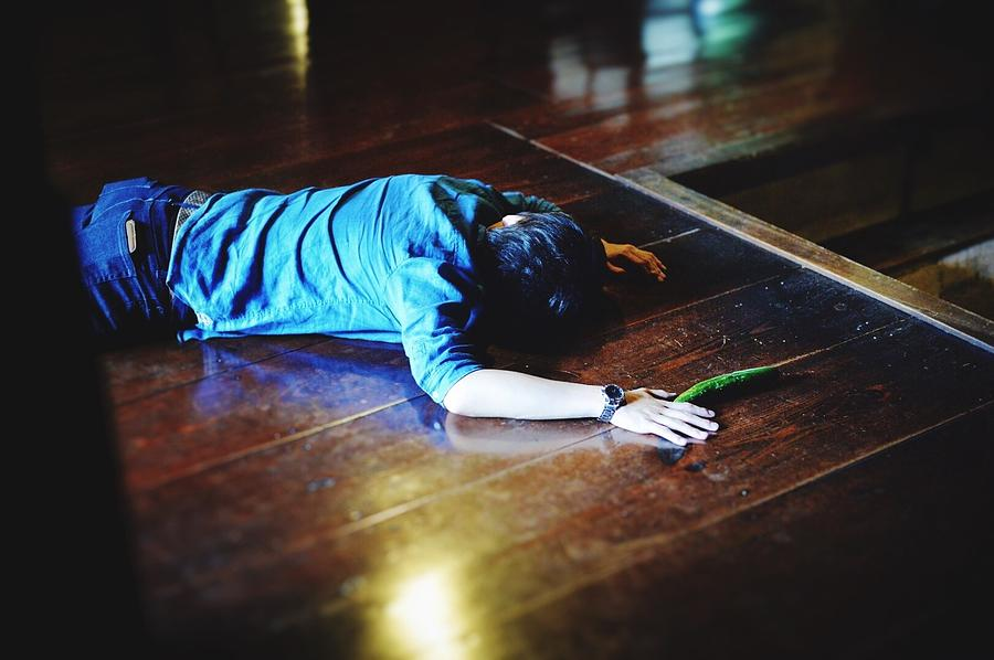 High Angle View Of Man Murdered On Hardwood Floor Photograph by Jusaburo Eguchi / EyeEm