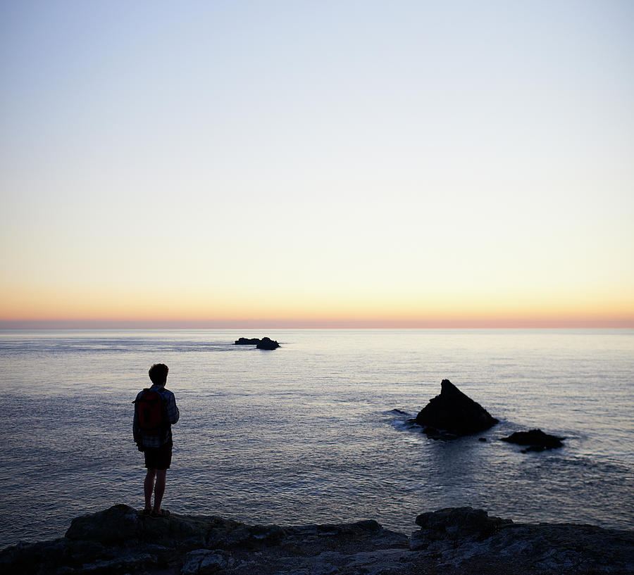 Hiker Looking Out To Sea Photograph by Dougal Waters