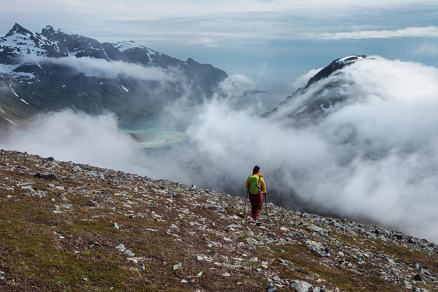 Walking Photograph - Hiker On Mountain Side Watching by Cody Duncan